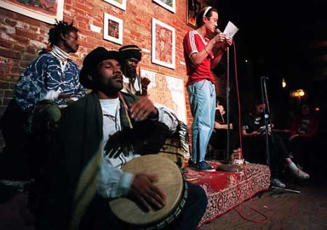 """Poets read at the Nuyorican Poets Café in New York, 1995."" Hispanic American Almanac: A Reference Work on Hispanics in the United States. Ed. Sonia Benson. 3rd ed. Detroit: Gale, 2010. Student Edition. Web. 1 Feb. 2013."